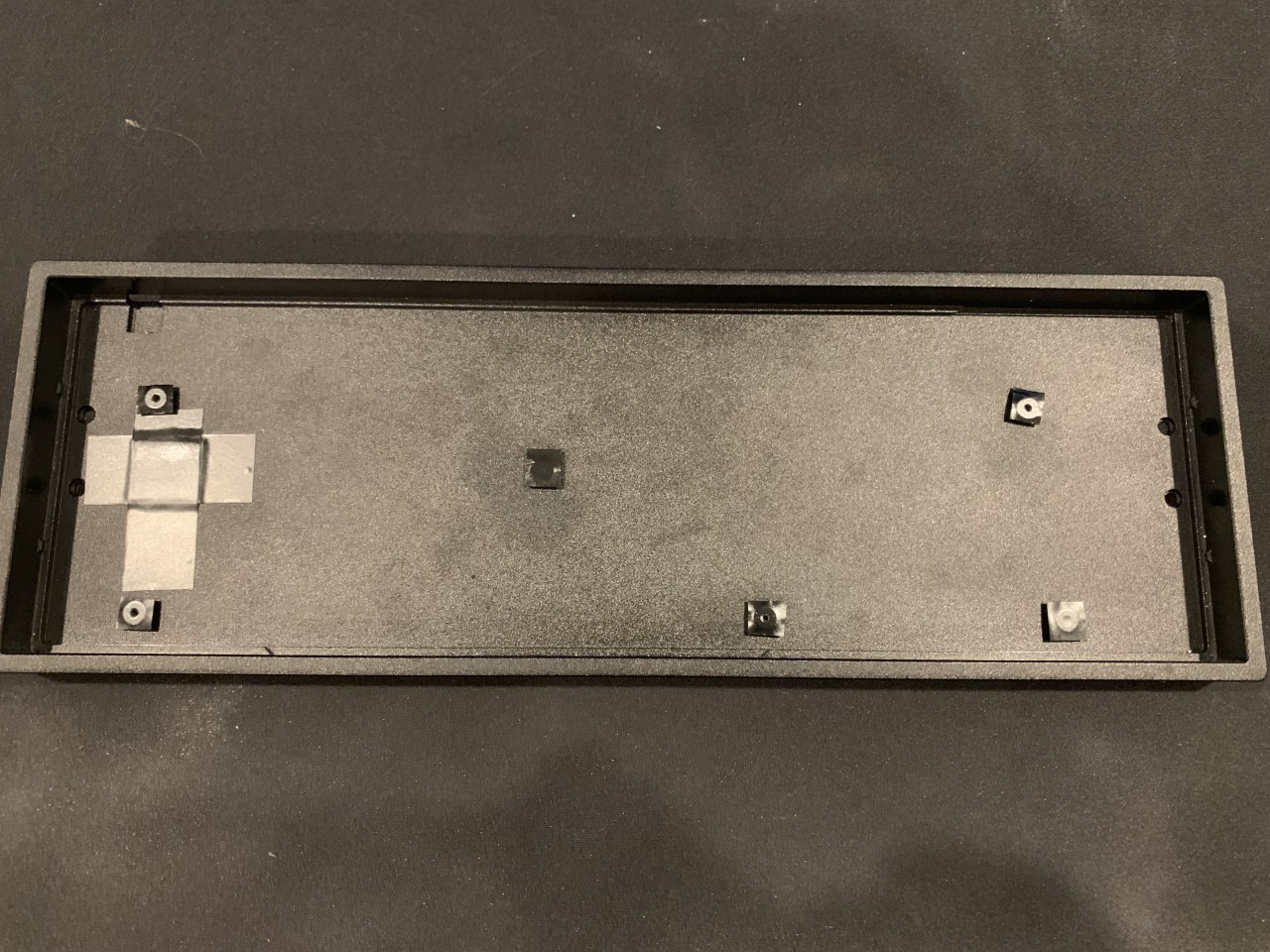 The TADA68 case risers touch the PCB, and only 4 of the 6 risers are used