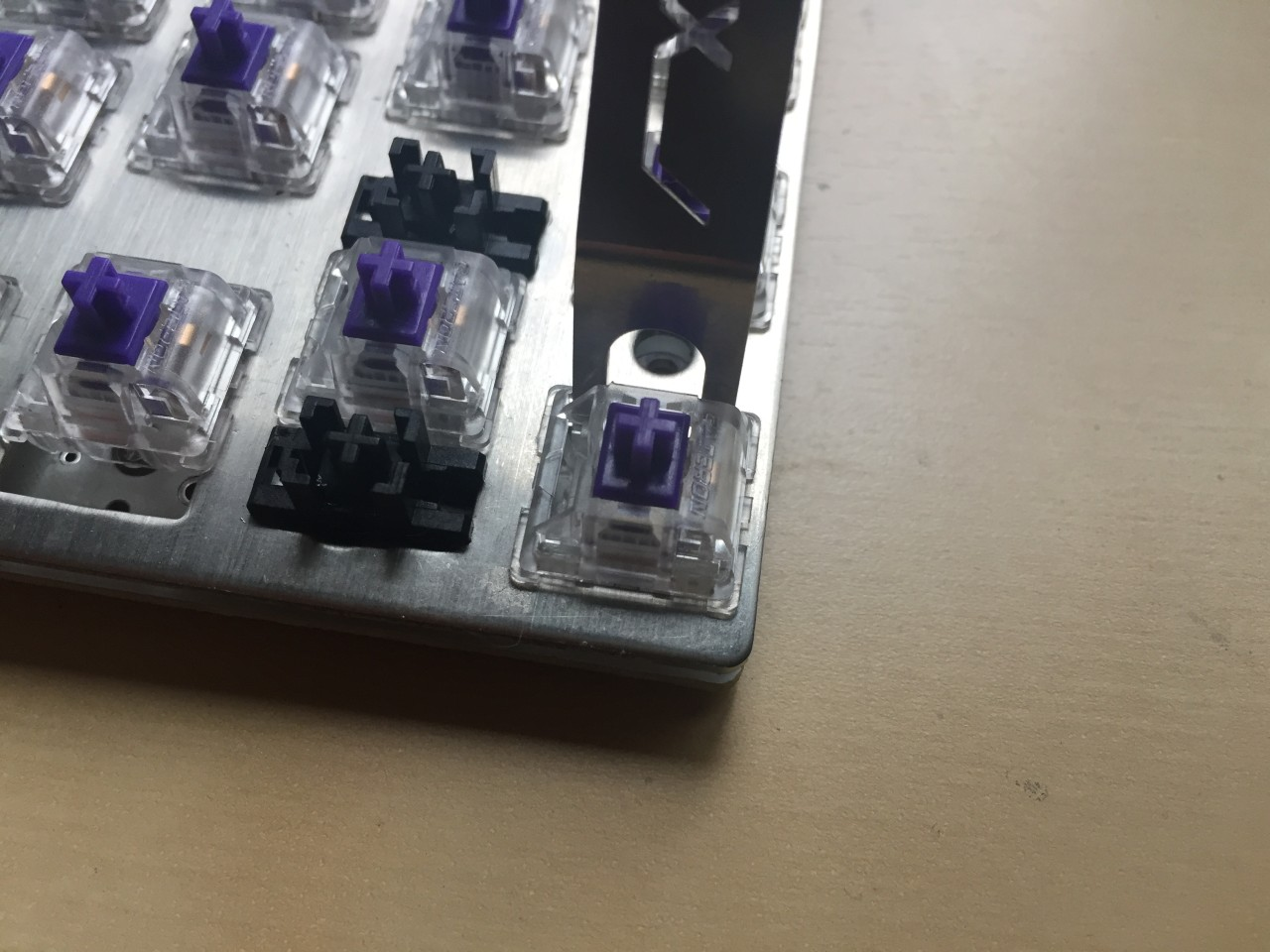 If your switches are already installed and soldered in, you may not be able to open them