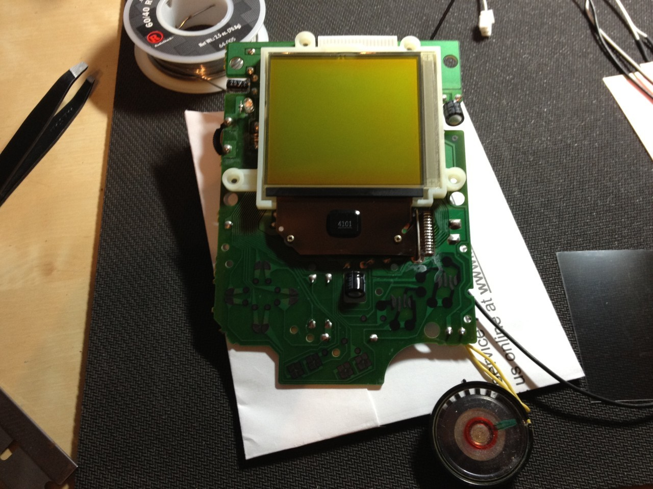 The front circuit board removed, with speaker