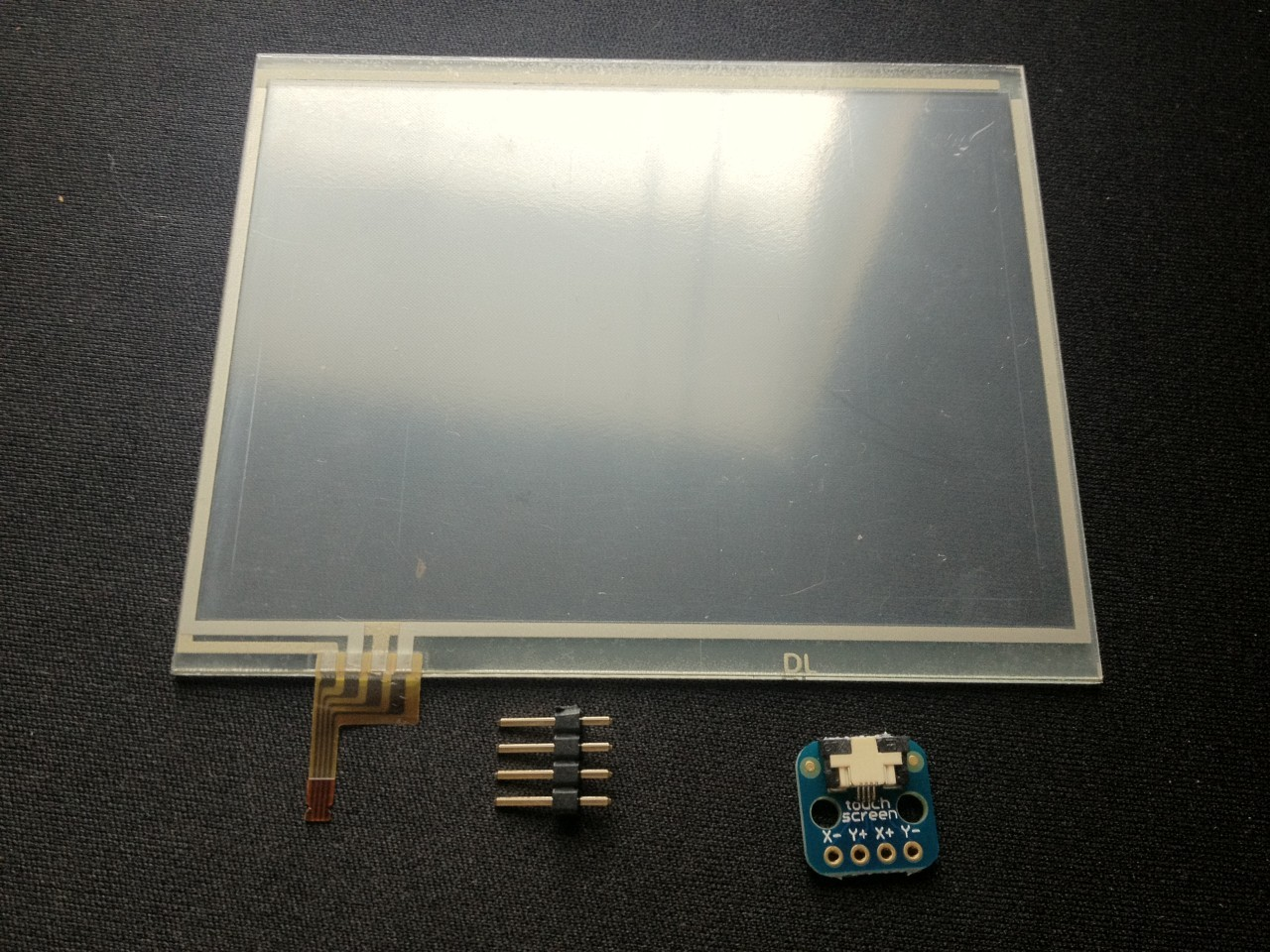 A Nintendo DS XL digitizer (touchscreen). Note that this is just the touch portion, there is no display.