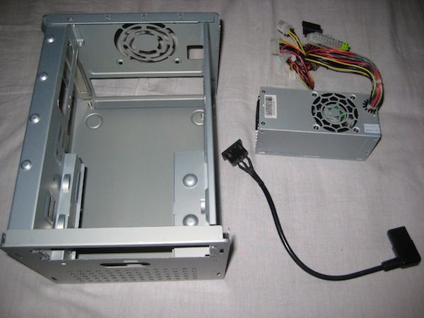 The Zotac Ion ITX-A-U board comes with an external power supply! So I can rip out the one that comes with the case